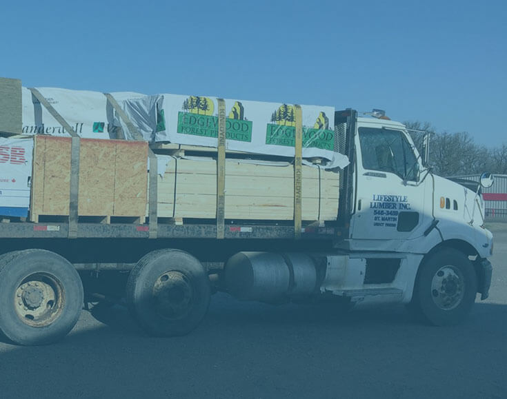 Lifestyle Lumber Delivery truck loaded with premium building supplies