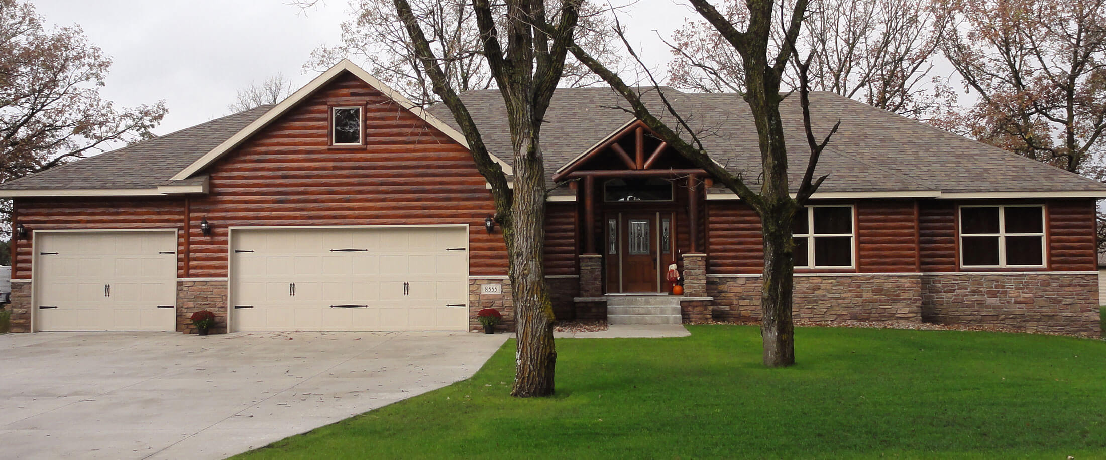 Exterior of a log style, single family home built by Lifestyle Lumber